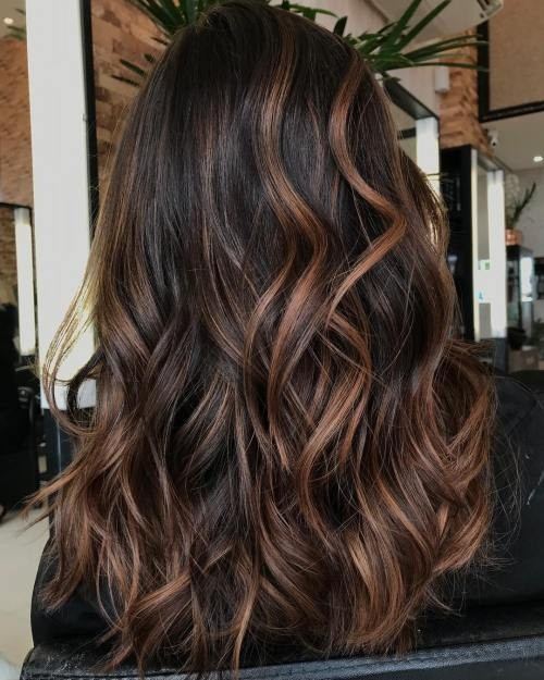 Dark-Wavy-Hair-with-Cinnamon-Highlights Impressive Haircuts and Hairstyles for Long Dark Brown Hair