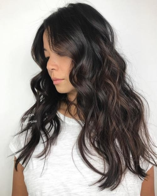 Glossy-Dark-Brown-Beach-Waves Impressive Haircuts and Hairstyles for Long Dark Brown Hair