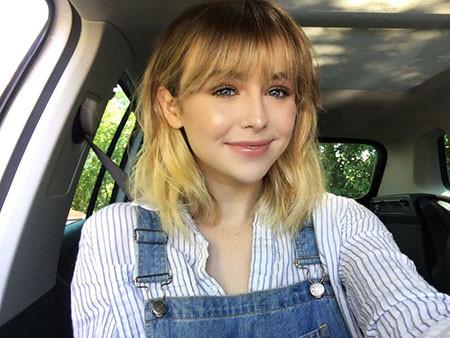 Wavy-Blonde Chic Short Haircuts with Bangs