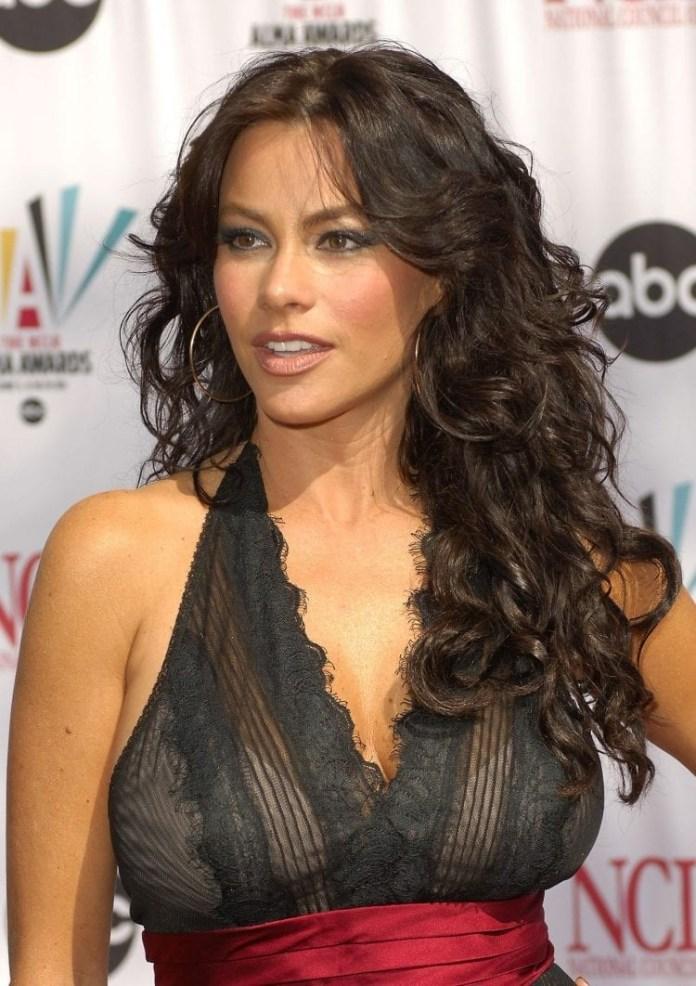 Sofia-Vergaras-Dark-Curls Hairstyles for Women Over 40