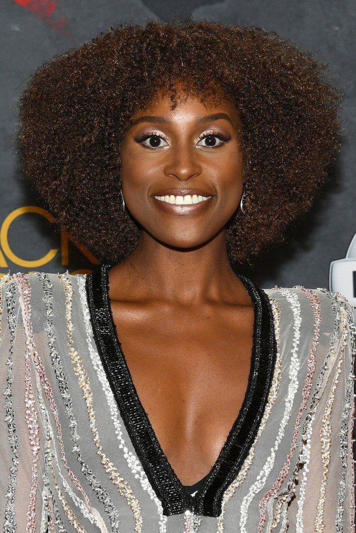 Tight-Voluminous-Curls Best Short Hairstyles for Black Women