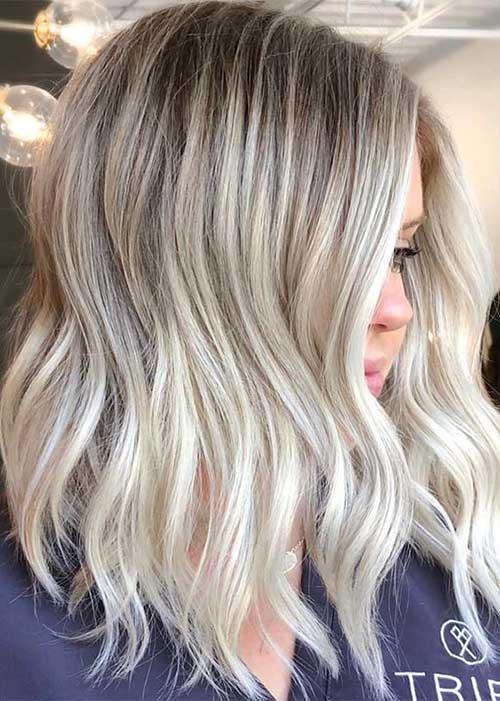Short-Blonde-Highlights-Wavy-Hair Modern Short Blonde Hairstyles for Ladies