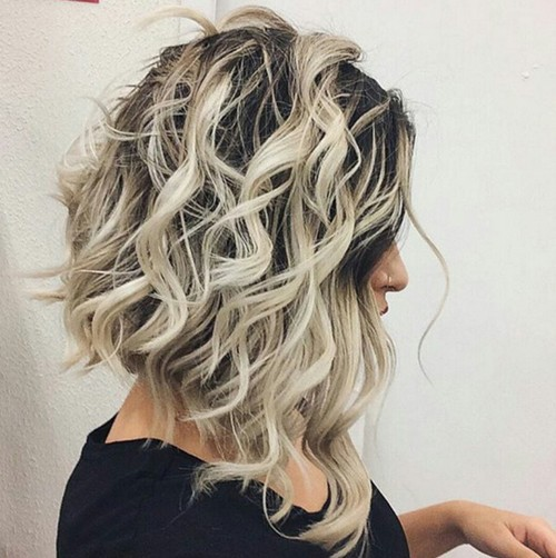 Medium-Wavy-Hairstyle-with-Highlights Flattering Medium Hairstyles for 2019