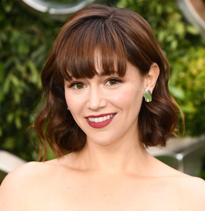 Hint-of-Waves-with-Bangs Loose Hairstyles to Look Relaxed and Ravishing