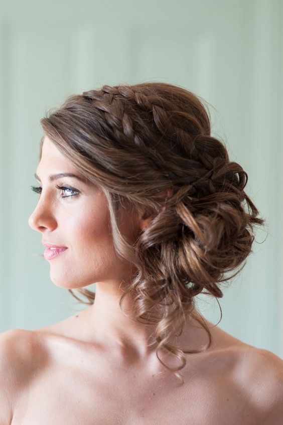 Loose-Bun-with-Double-Braids Wedding Hair Ideas for Spring