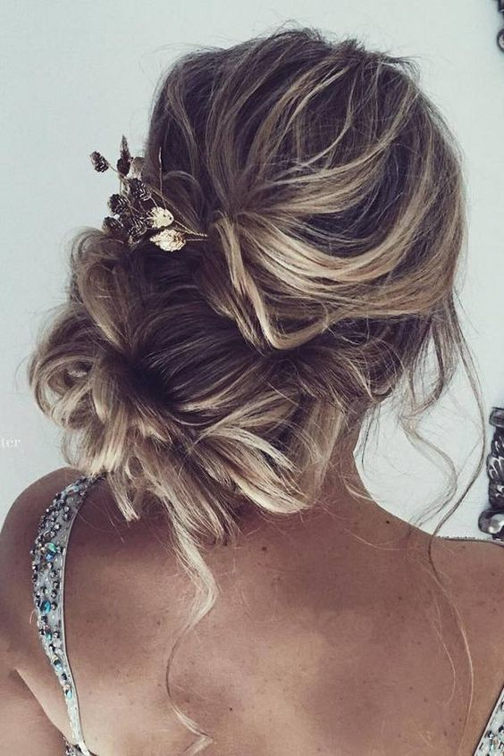 Low-Bun-for-Curly-Blonde-Hair Wedding Hair Ideas for Spring