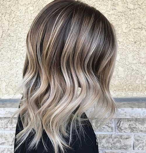Short-Medium-Blonde-Hair-Side-Part Latest Short to Medium Hairstyles