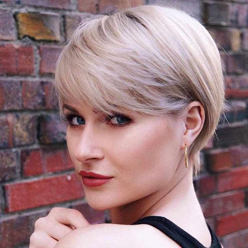Short-Pixie-Layered-Hair-Cut-with-Bangs Cute and Chic Ways to Have Short Hair with Bangs
