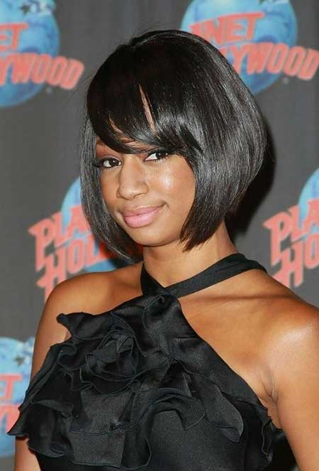 Sleek-Asymmetric-Bob-Haircut-with-Side-Swept-Bangs Super Short Haircuts for Black Women
