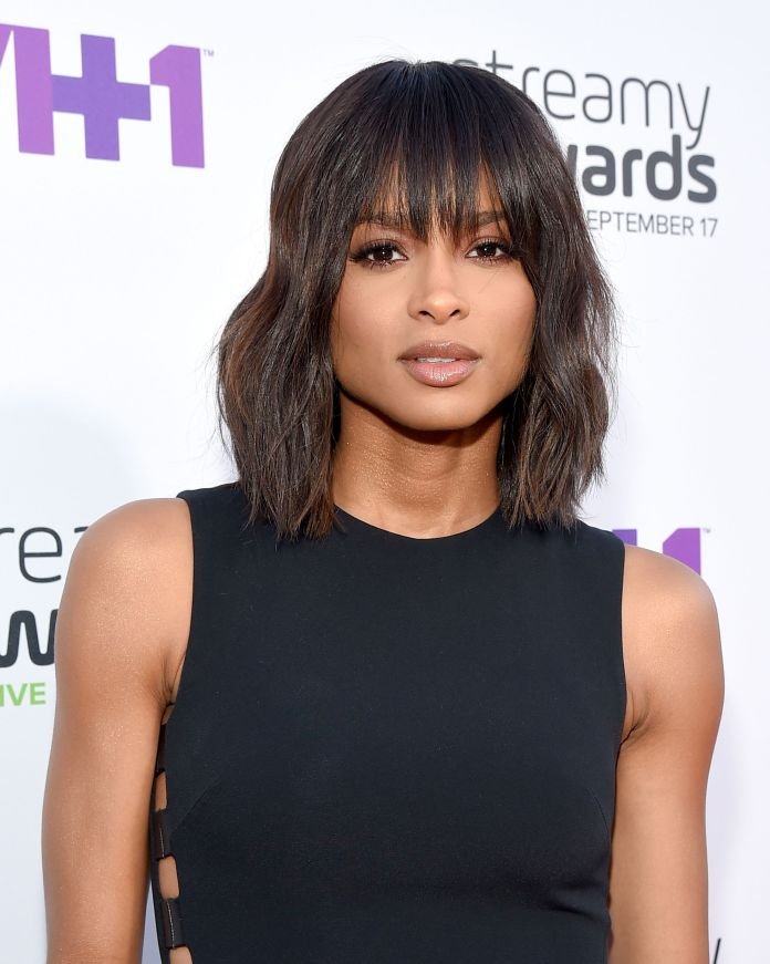 Wavy-Bob-with-a-Fringe Top Trending Medium Hairstyles for Girls