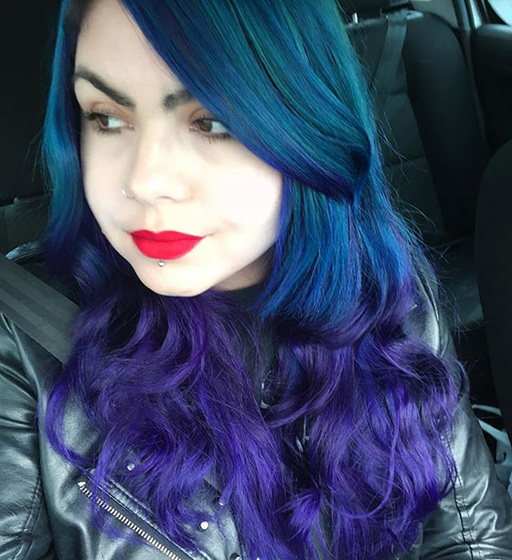 Bouncy-Blue-And-Purple-Curls-With-Side-Swept-Bangs Layered Hairstyles With Bangs