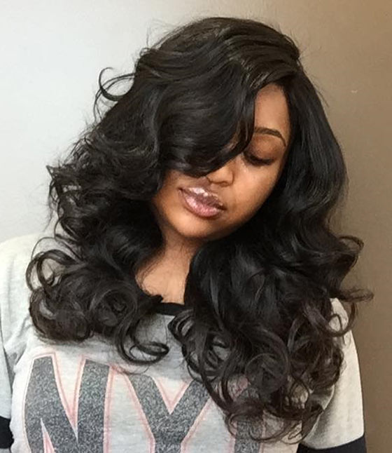 Bouncy-Curls-And-Voluminous-Bangs Layered Hairstyles With Bangs