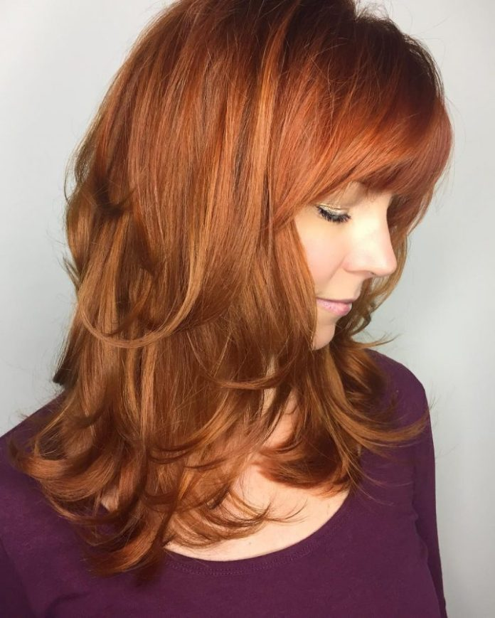 Red-Feathered-Out-Layers Layered Hairstyles With Bangs