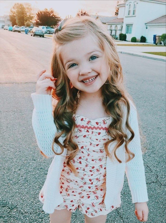 Top-Knot-Silky-Hairstyle Cute and Adorable Little Girl Haircuts