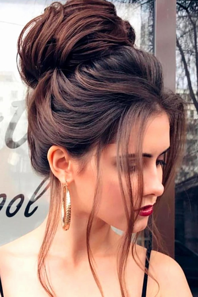 A-Puffy-Floral-High-Bun-with-Long-Straight-Fringes Christmas Party Hairstyles to Enhance Your Look