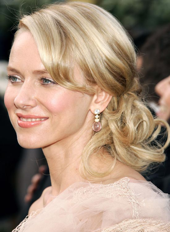 Curly-Low-Side-Hairdo-With-Side-Swept-Bangs Bridal Hairstyle Ideas For Your Reception