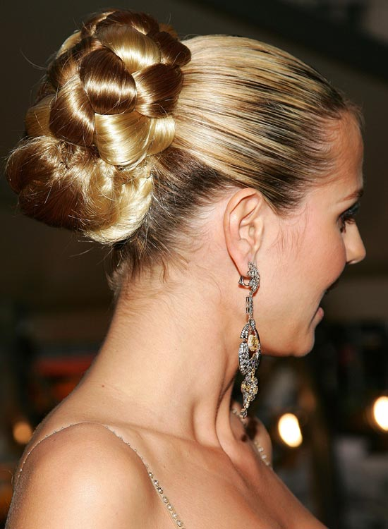 Huge-Half-Braided-Bun-With-Smooth-Top Bridal Hairstyle Ideas For Your Reception