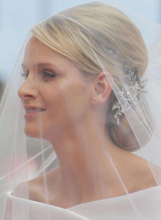 Low-Bun-With-Mini-Bouffant-and-Side-Sweep Bridal Hairstyle Ideas For Your Reception
