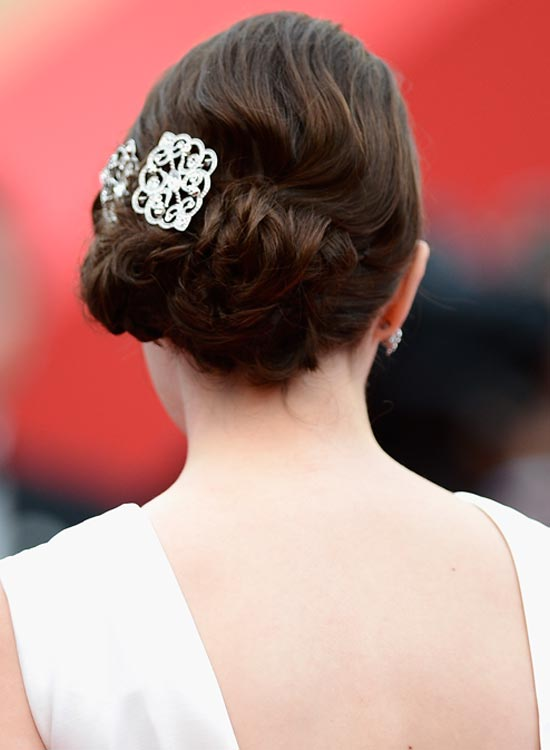 Low-Flowery-Hairdo-With-Twisted-Side Bridal Hairstyle Ideas For Your Reception