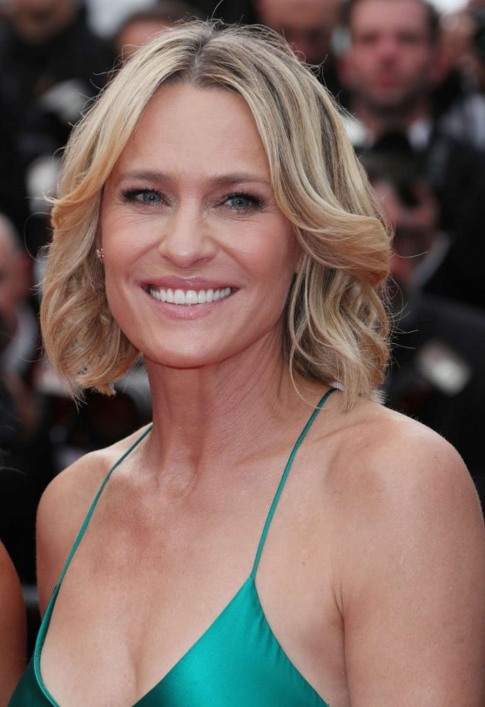 Center-Parted-Long-Bob-with-Curls Bob Hairstyles for Women Over 50 – Be Hot And Happening
