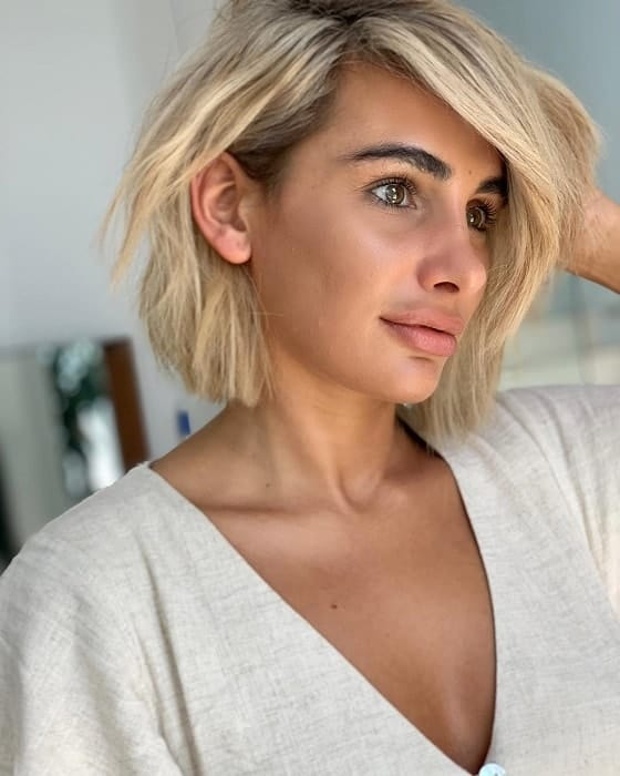Messy-Blonde-Bob-with-Bangs Exotic Messy Bob Hairstyles That Women Love