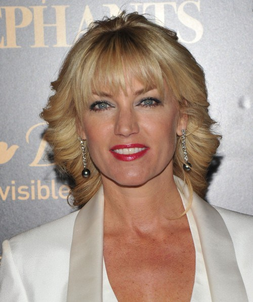 Blonde-Swept-Back-Curls-with-Bangs Easy Hairstyles for Women Over 50
