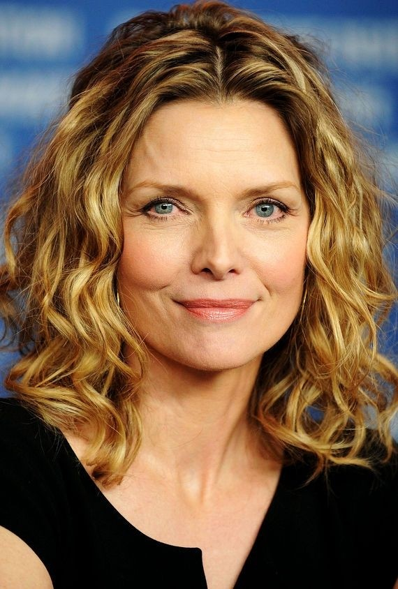 Blonde-Wavy-Medium-Haircut Wavy Hairstyles for Women Over 50 – Look Young And Beautiful