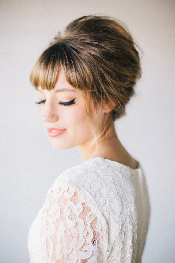 Blonde-and-Brown-Puffed-Side-Bun-with-Short-Front-Bangs Most Beautiful Wedding Hairstyles with Bangs