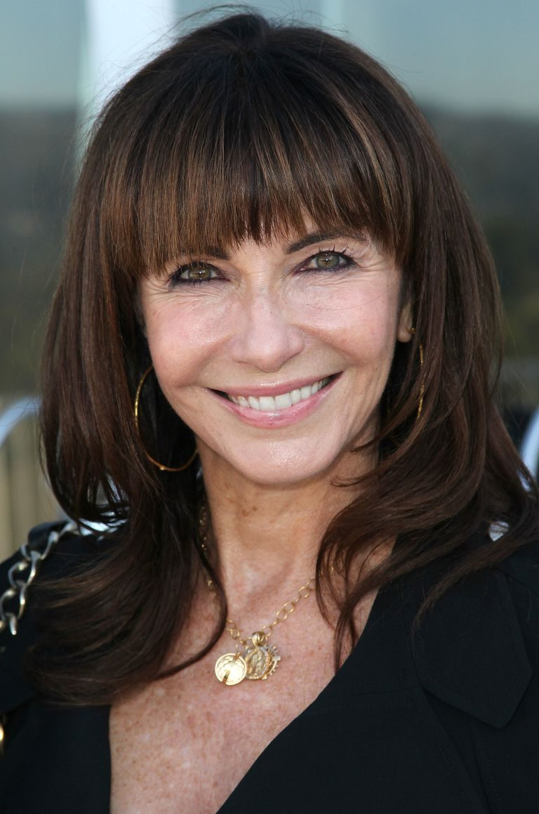 Brunette-Hair-with-Blunt-Bangs Hairstyles for Women Over 60 To Look Stylish