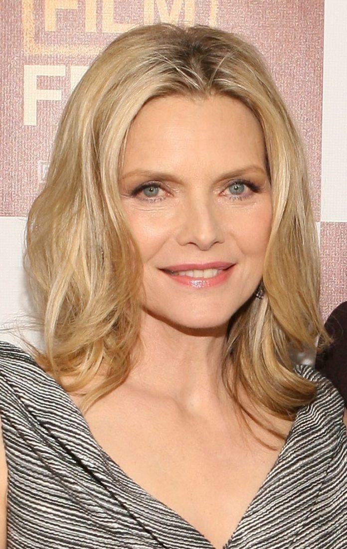 Center-Parted-Blonde-Hairstyle-with-Waves Medium Hairstyles for Women Over 50