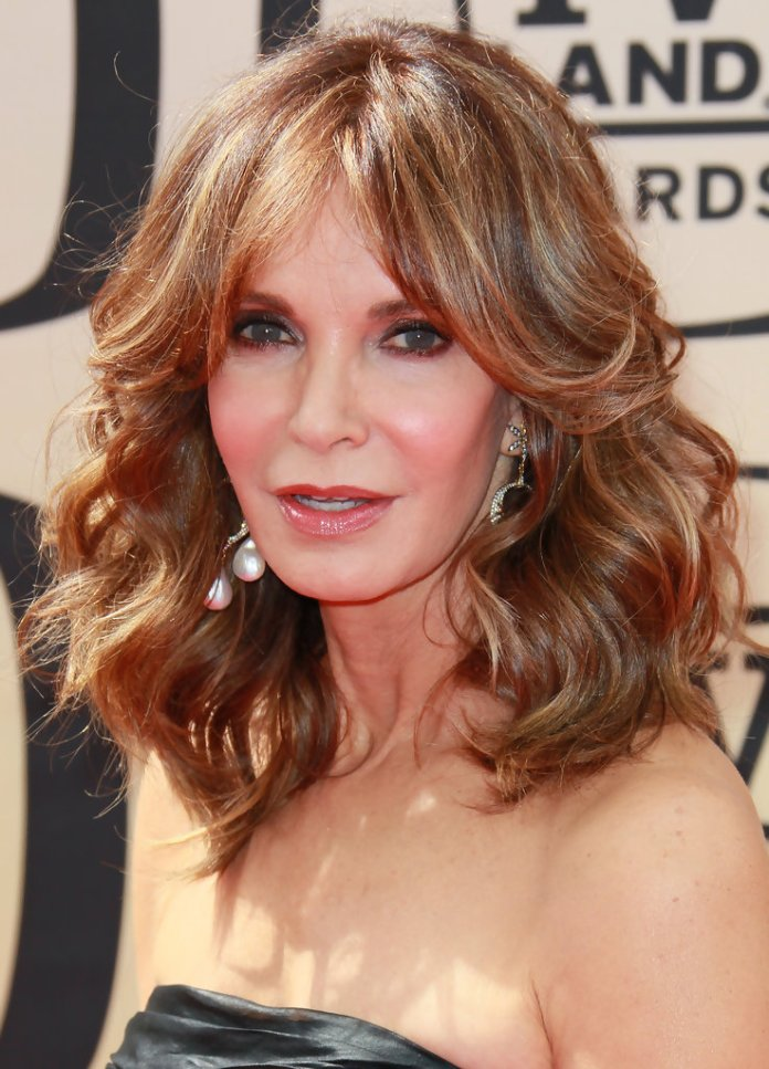 Feathered-Layered-Hairstyle Hairstyles For Women Over 50 With Bangs