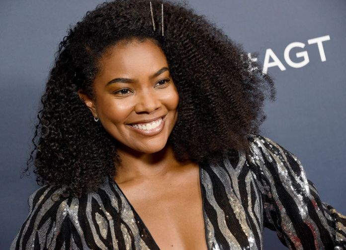 Gabrielle-Unions-Shoulder-Grazing-Style Stunning Curly Hairstyles That Are All About That Texture