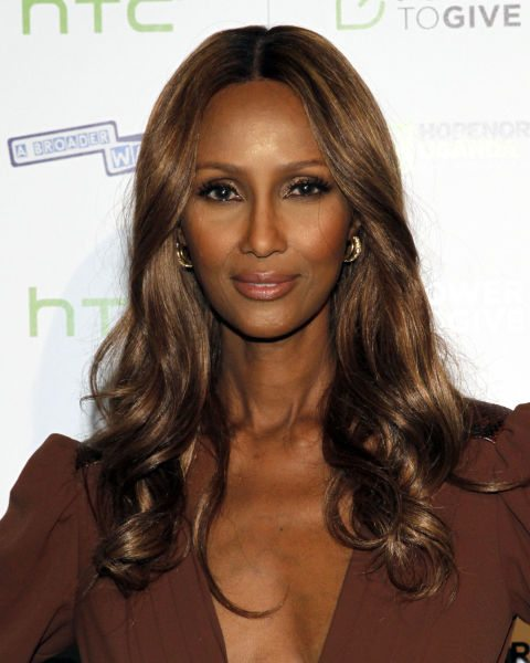 Glossy-Long-Wavy-Hair-with-Curls Long Hairstyles for Women Over 50 – Look Trendy And Fashionable