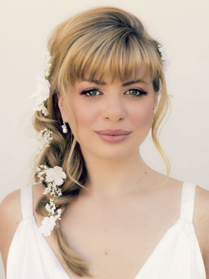Loose-Braid-and-Front-Bang-Ornamented-with-Hair-Accessory Most Beautiful Wedding Hairstyles with Bangs