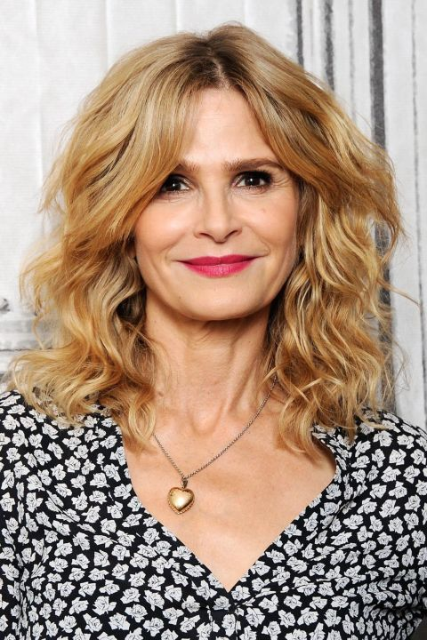 Medium-Blonde-Hair-with-Face-Framing-Bangs-and-Curls Curly Hairstyles for Women Over 50