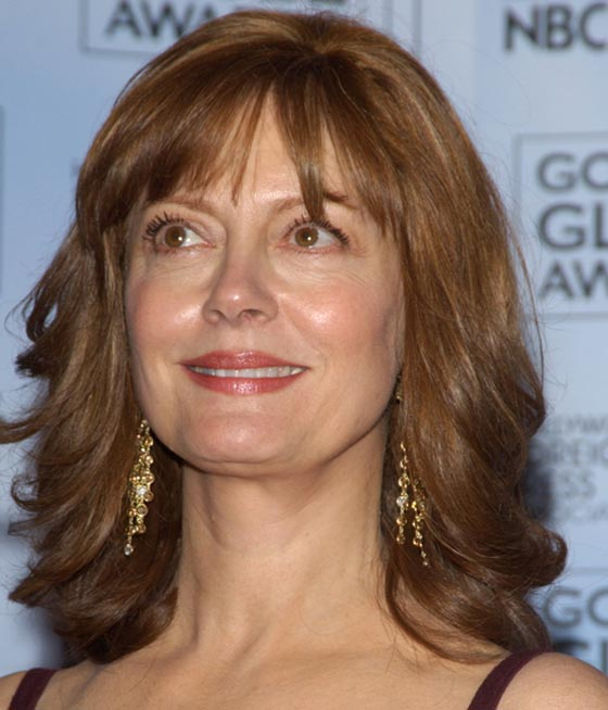 Medium-Hair-with-Curls-and-Bangs Curly Hairstyles for Women Over 50