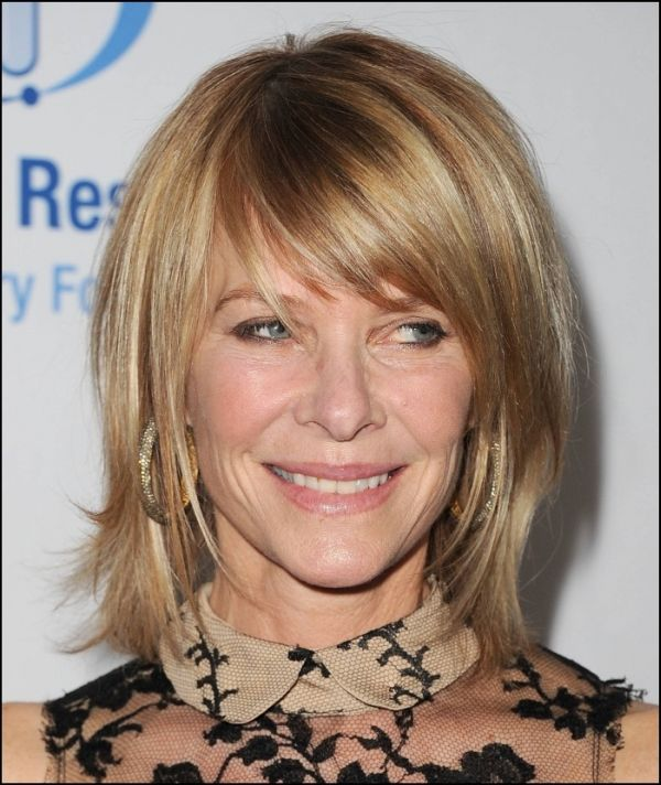 Medium-Layered-Bob-with-Side-Bangs Medium Hairstyles for Women Over 50