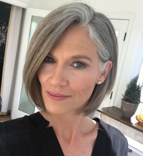 Classy-Side-Parted-Chin-Length-Bob 14 Stylish Gray Hair Styles for older women