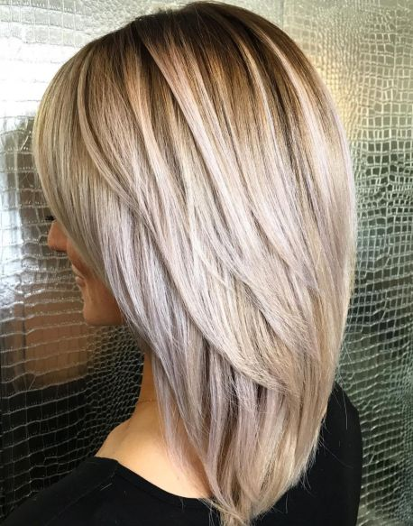 Elongated-Layered-Cut-with-Voluminous-Crown-mediumhairstyles-for-thick-hair 15 Graceful Medium Length Haircuts for Thick Hair