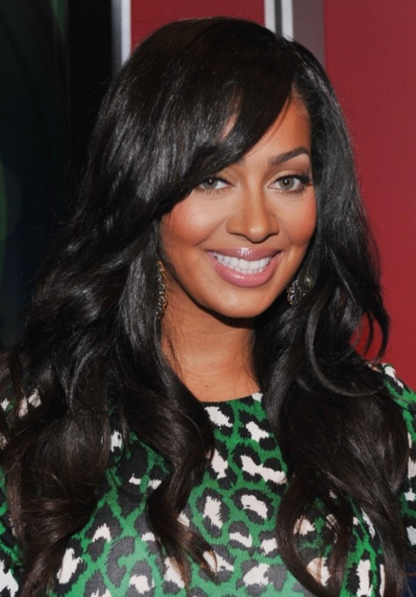 Glossy-Black-Hair-with-Wavy-Curls-and-Bangs Awesome Long Hairstyles for Black Girls