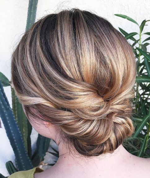 Lovely-Twisted-and-Tied-Updo 12 Stunning Updos For Medium Length Hair