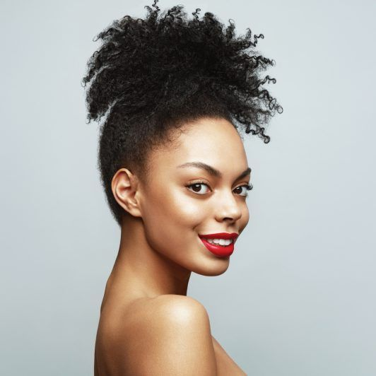 Natural-Puff-Updo 16 Stunning Natural Hairstyles for Black Women