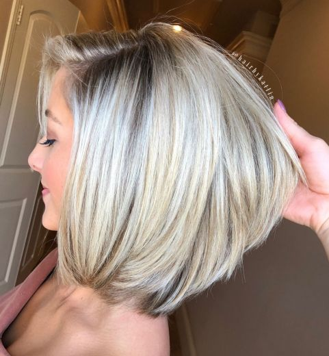 Perfect-Layered-Blonde-Bob-with-Bangs 12 Winning-looks Layered Bob Hairstyles