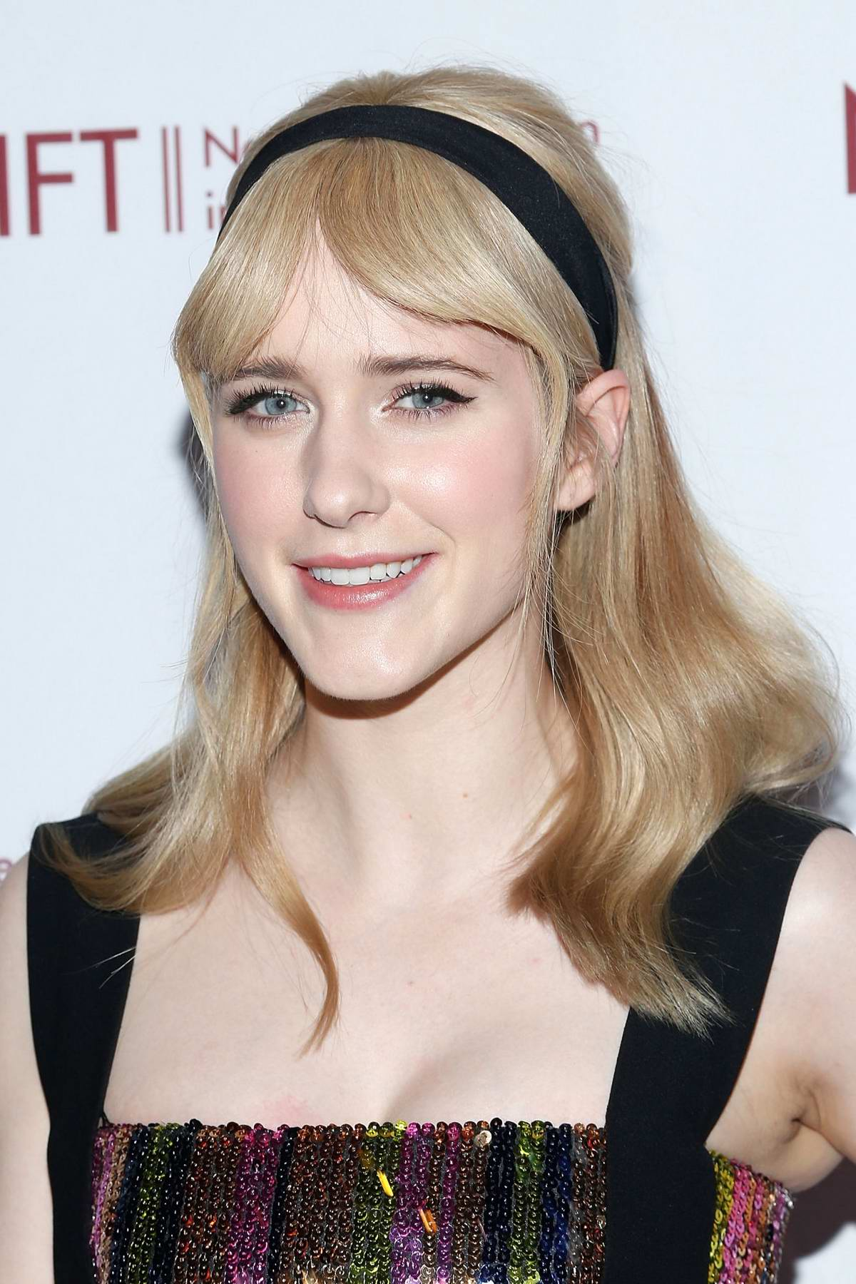 Pure-Blonde-Hair-with-Middle-Parted-Bangs Most Trendy and Terrific Medium Hairstyles 2020