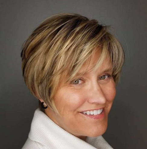 Rounded-Pixie-with-Dimensional-Highlights 12 best pixie hairstyles for women over 50