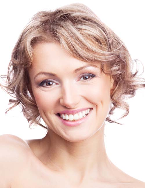 Short-Stacked-Layers-On-Soft-Curls Top 10 Glamorous layered curly hairstyles
