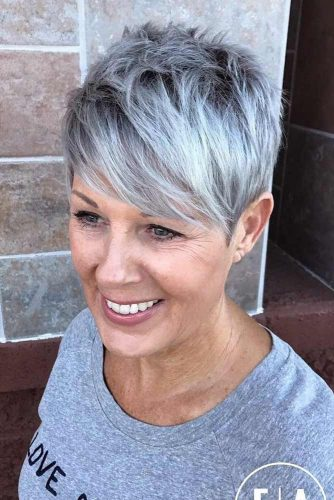 Silver-Feathered-Pixie-Cut Elegant Pixie Hairstyles For Women over 50