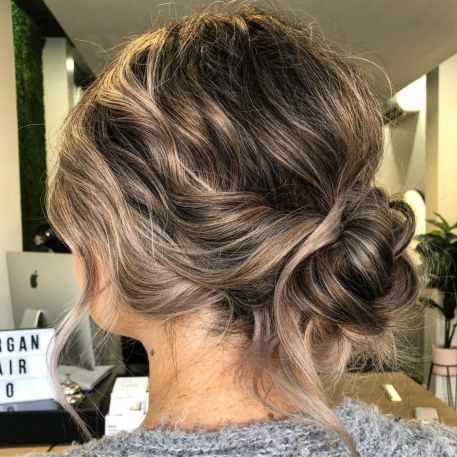 Wavy-Messy-Low-Bun-Updo 12 Stunning Updos For Medium Length Hair