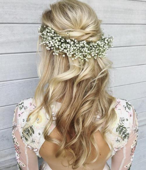 Bohemian-Curls-with-Floral-Clip 15 Stylish Half Up Half Down Wedding Hairstyles for Brides