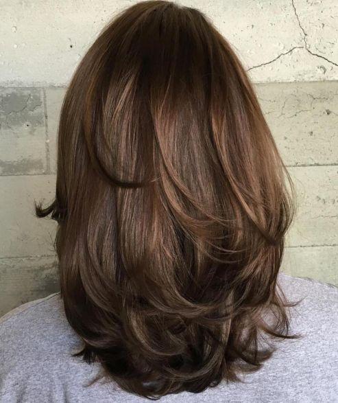 Bouncy-Layers-1 14 Sensational Medium Length Haircuts for Thick Hair